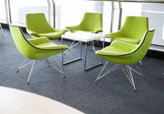 Green Stylish Chair in meeting room Royalty Free Stock Image