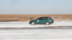Green subaru Impreza on ice track. Moscow, Russia - March 1st, 2014: Moscow Subaru Forester club championship. This stage was located in Moscow, on the frozen Stock Photos