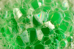 Green suds. From dish washing soap Royalty Free Stock Images