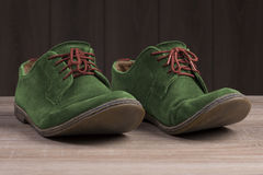 Green suede shoes with red laces. Stock Image