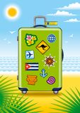Green suitcase for travel with stickers Stock Images