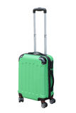 Green suitcase on wheels for travel Royalty Free Stock Photos