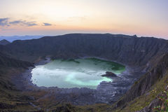 Green sulfuric lake in volcanic crater Royalty Free Stock Photography