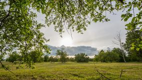 Green summer field. Timelapse footage. Epic sky. Stormic weather. stock video footage