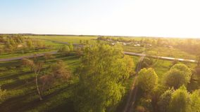 Green summer park. Sunset. Camera around. Aerial footage. stock footage