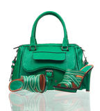 Green summer shoes and handbag over white Royalty Free Stock Photos