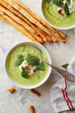 Green summer soup with grissini Royalty Free Stock Image