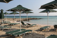 Green sun umbrellas on Elafonissi beach - Crete Royalty Free Stock Image