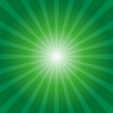Green sunburst background. With light rays Stock Photos