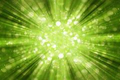 Green Sunburst Background With White Bokeh Stock Photography
