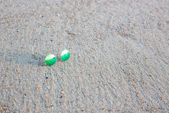 Green sunglasses in the sand Stock Image
