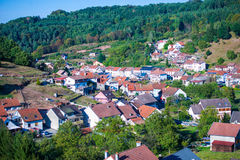 Green and sunny mountain french village. Sunny day in french mountain village and forest Stock Photo