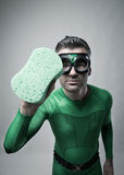 Green superhero cleaning with a sponge Stock Photo