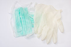 Green surgical mask and white gloves Stock Image