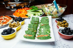 Green sushi on the table. In a restaurant Stock Photography