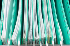 Green suspension folder with paperwork hang in cabinet Stock Image