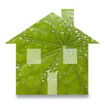 Green Sustainable Home Leaf Renewable Energy. An image that explores renewable energy in homes with a house shaped leaf with water drops Royalty Free Stock Images