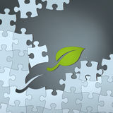 Green Sustainable Solution. Puzzle with green leaf as the missing piece. Fully scalable vector illustration Stock Photo