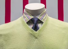 Green Sweater, Shirt, Blue Tie (front view). Close-up of a light green v-neck sweater with striped shirt and blue tie royalty free stock photography