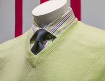 Green Sweater, Striped Shirt, Blue Tie (side view). Close-up of a light green v-neck sweater with striped shirt and blue tie Royalty Free Stock Images