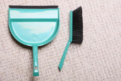 Green sweeping brush and dustpan on floor - housework. Green sweeping brush and dustpan for house work on floor indoors. Cleaning Stock Image