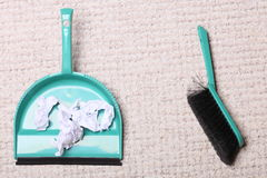 Green sweeping brush dustpan with garbage, housework Stock Photos