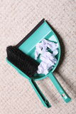 Green sweeping brush dustpan with garbage, housework Royalty Free Stock Image