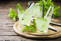 Green sweet alcohol cocktail with mint and ice Royalty Free Stock Photography