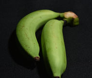 Green sweet banana on blackground Royalty Free Stock Images