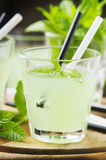 Green sweet cocktail with fresh mint and ice Royalty Free Stock Image