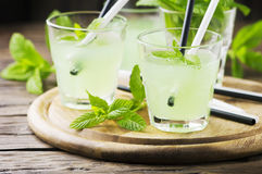 Green sweet cocktail with mint and ice Royalty Free Stock Photos