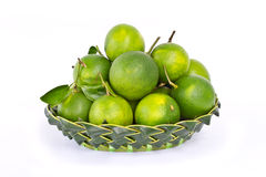 Green sweet oranges in coconut leaves basket Stock Photo