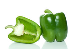 Green sweet pepper and half. Isolated on the white background Royalty Free Stock Photo