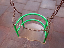 Green swing on chains Stock Photos