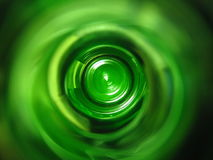 Green swirl background. A green swirl background design from shooting through a bottle Royalty Free Stock Photography