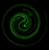 Green Swirling Spiral on Black Background Royalty Free Stock Images