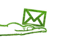 Green symbol email in the hand Stock Image
