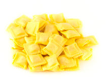 Green; symbol; leaf; icon; nature; tree; ; l. Crude yellow macaroni in bulk on a table royalty free stock photos