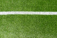 Green synthetic artificial grass soccer sports field with white corner stripe line stock image