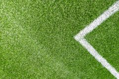 Green synthetic artificial grass soccer sports field with white corner stripe line stock photography