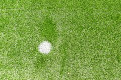 Green synthetic artificial grass soccer sports field with white penalty mark stock image