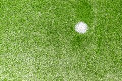 Green synthetic artificial grass soccer sports field with white penalty mark royalty free stock image