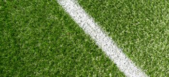 Green synthetic grass soccer sports field with white corner stripe line stock photography