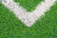 Green synthetic grass sports field with white line Royalty Free Stock Images