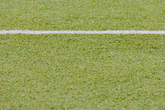 Green synthetic grass sports field with white line shot Royalty Free Stock Images