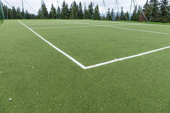 Green synthetic grass sports field with white line. Sport background Royalty Free Stock Images