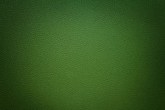 Green synthetic leather  background with vignette. Green  synthetic leather texture background with vignette Stock Photography
