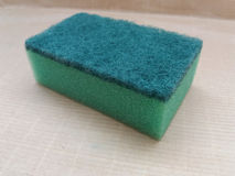 A green synthetic sponge Stock Image