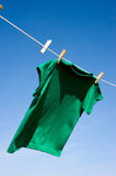 A Green T-Shirt on Clothesline Stock Images