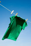 A Green T-Shirt on Clothesline Royalty Free Stock Photography